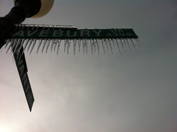 A frozen, iced out street sign. - The 30 Most Amazing Photos Of Frozen Things In Honor Of The Coldest Morning Of The 21st Century