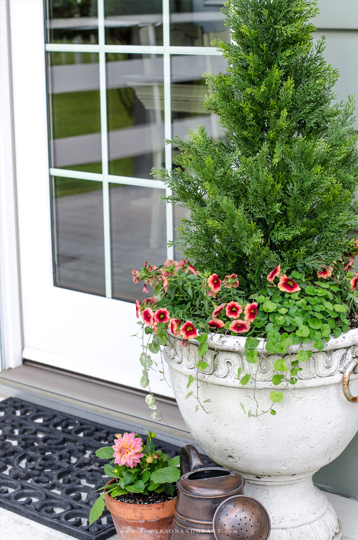 Faux shrubs and bushes are a great alternative to the real thing when planted in pots and containers for your porch.  Learn where to find these plants and how to make them look as real as possible to easily enhance your home's curb appeal.  #frontporch #summer #gardening #curbappeal