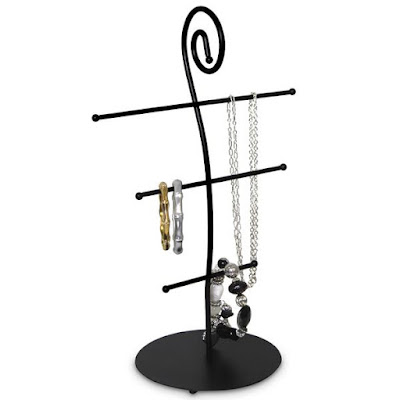 Black metal displays like the Metal Necklace Display Stand from Nile Corp are ideal for gold jewelry