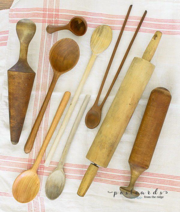 collection of vintage wooden spoons and kitchen utensils