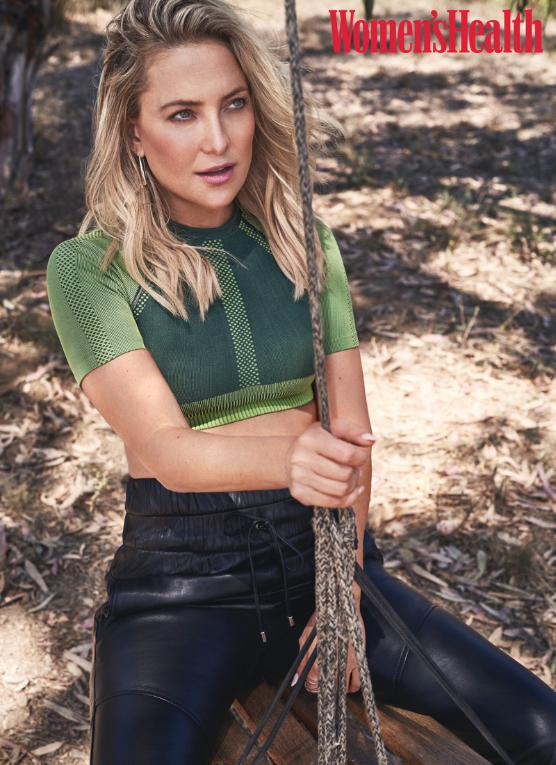 Kate Hudson wears a Fabletics top and Marissa Webb joggers