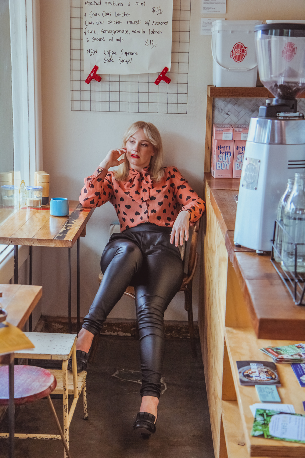 Liana of @findingfemme in black leather pants and pussy bow shirt