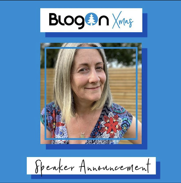 Blue background with text Blog On Xmas Speaker Announcement, with a head and shoulders picture of grey haired me smiling at the camera