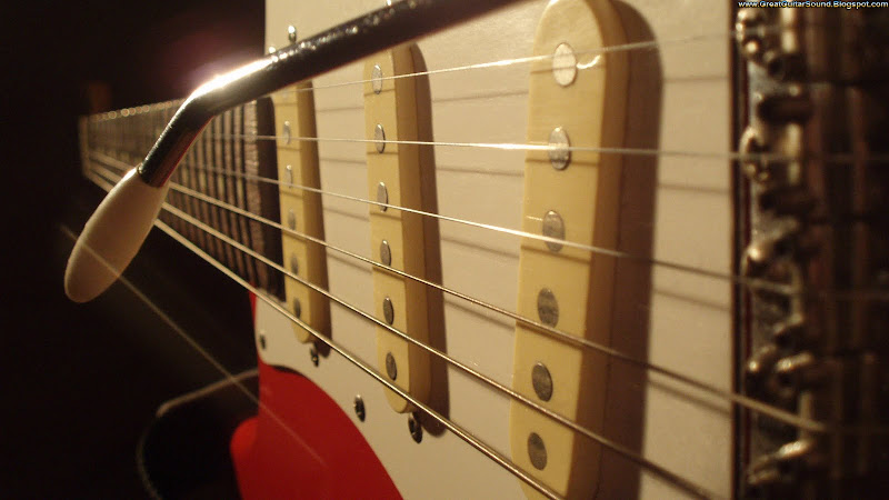Guitar Wallpaper - Red Fender Stratocaster Electric Guitar Bridge  title=