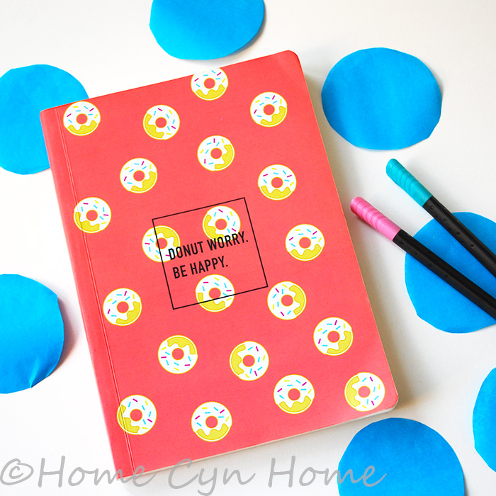 A ruled notebook with a donut cover
