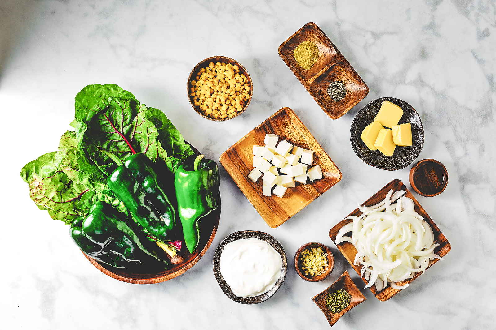 Ingredients include poblanos, chard, corn, onions, cheese, Mexican crema.