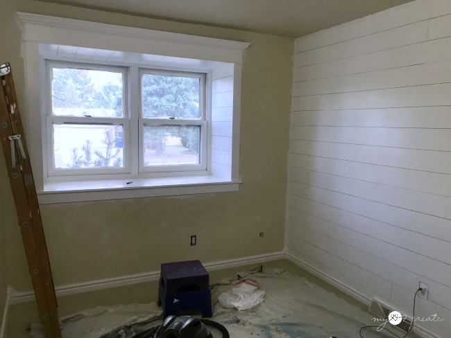 painting trimmed window and plank wall