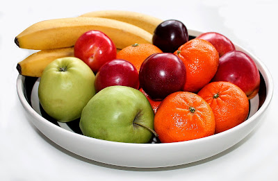 Bowl of fresh fruit: Bananas, tangerines, apples, plums