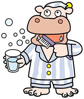 パジャマ姿のカバが歯磨きをしている