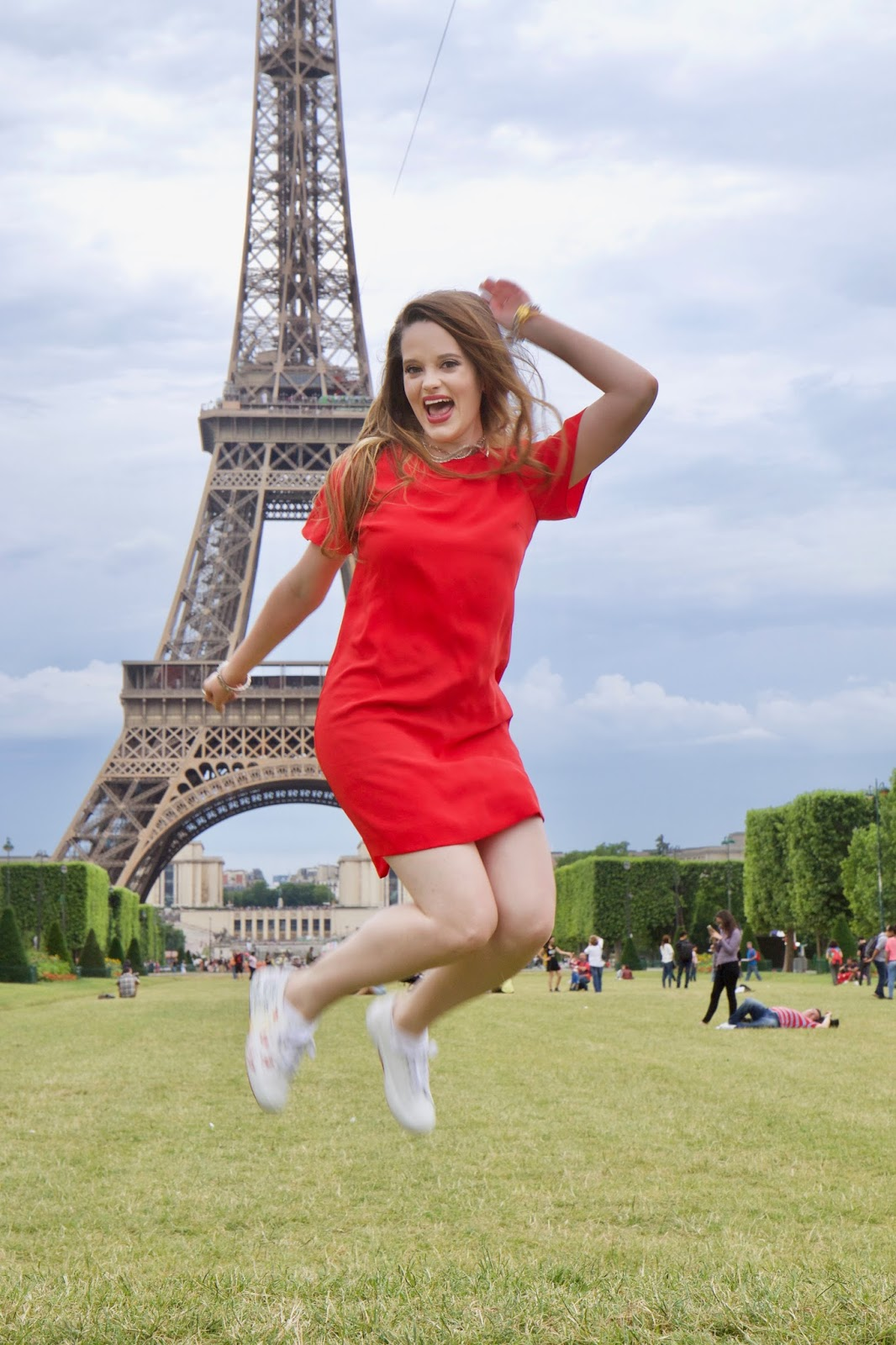 Fashion blogger Kathleen Harper in front of the Eiffel Tower in Paris France