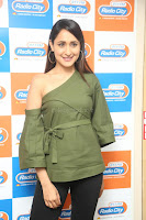 Pragya Jaiswal in a single Sleeves Off Shoulder Green Top Black Leggings promoting JJN Movie at Radio City 10.08.2017 121.JPG