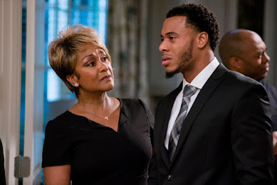 Jen Harper and Courtney Burrell argue at a funeral in the movie Tyler Perry's A Madea Family Funeral