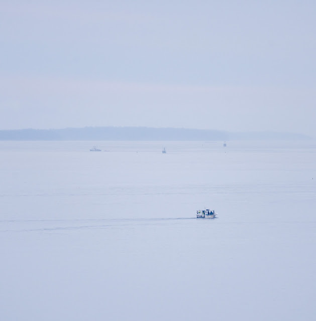 Portland, Maine July 2021 photo by Corey Templeton. A little grey boat heading out into the big blue sea.