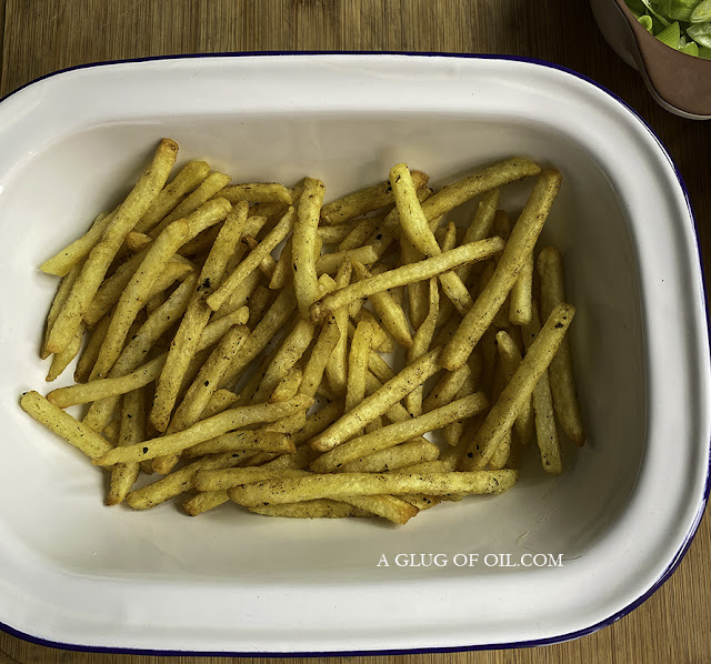 oven chips sprinkled with cajun seasoning out of the oven