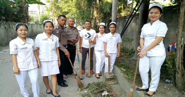 Unit Binmas Polsek Medan Baru Gotong Royong Bersama Akbid Prima Indonesia dan Warga