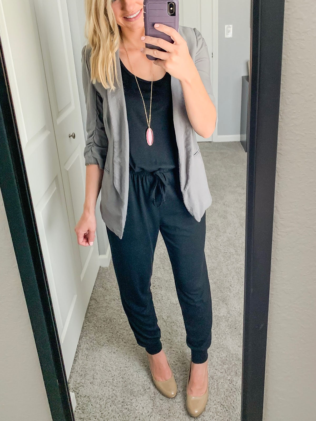 Black jumpsuit styled with a blazer