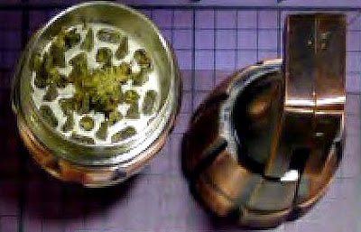 Discovered a replica grenade tobacco grinder with a small amount of marijuan inside
