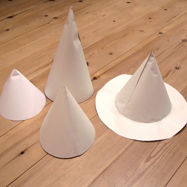 Witches hats made out of scrap paper.