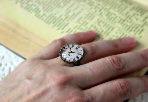 https://www.etsy.com/listing/190256287/retro-style-clock-face-ring-adjustable?ref=favs_view_3
