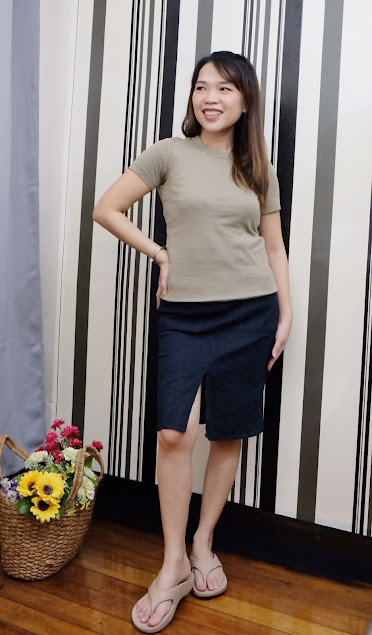 A photo of Nikki Tiu wearing Uniqlo U Crew Neck Short Sleeves Olive and Bayo Skirt