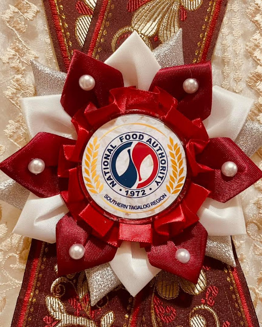 Red and white event leis for NFA Region IV in Balagtas, Batangas