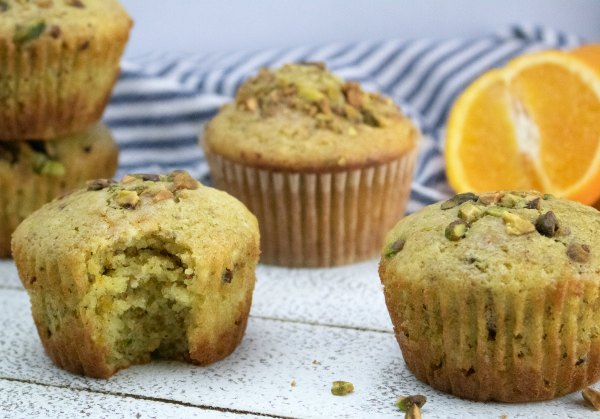 ready to eat orange pistachio muffins with orange half and pistachio pieces