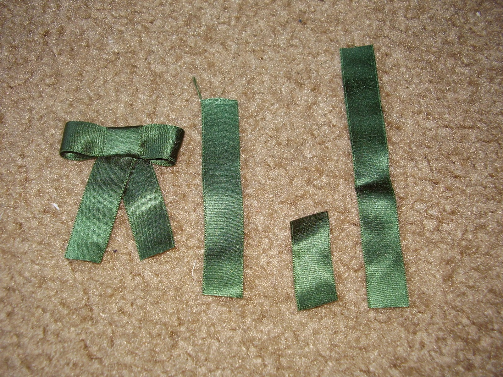 Pieces for constructed silk ribbon bow.