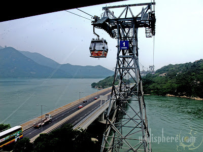 Cable cars passing the bridge highway