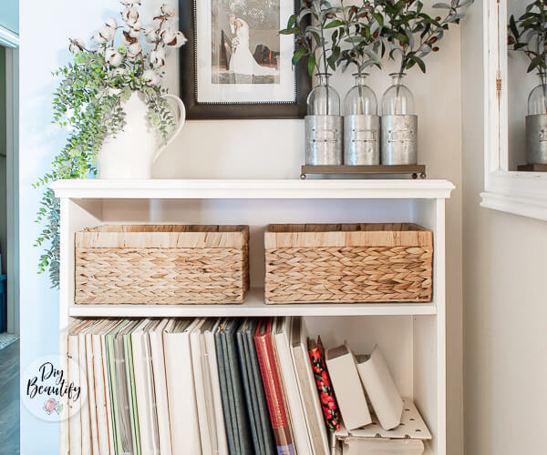 white bookcase with fabric covered albums