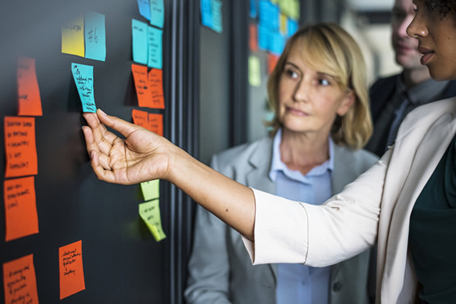 business people planning tasks with sticky notes