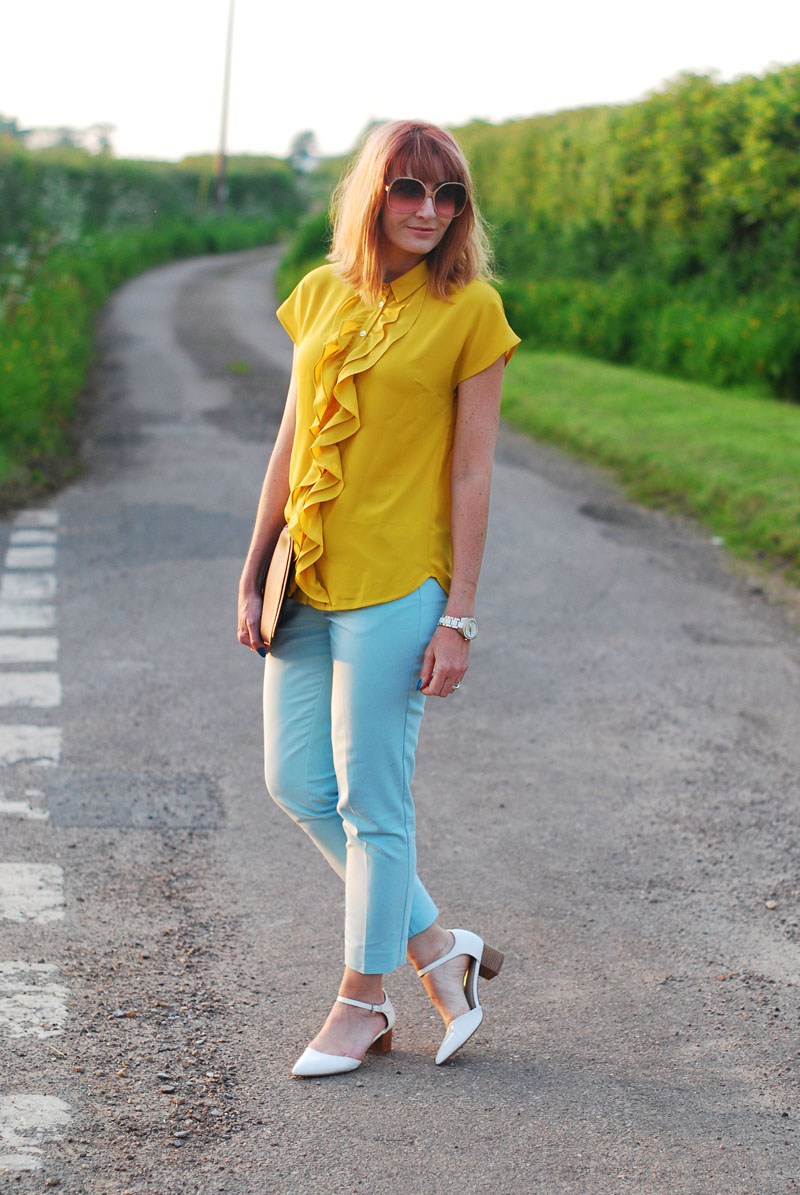 Summer brights: Ruffled yellow blouse, mint trousers, low pointed white heels, Jennifer Hamley Model KT Workbag clutch, oversized 70s sunglasses | Not Dressed As Lamb