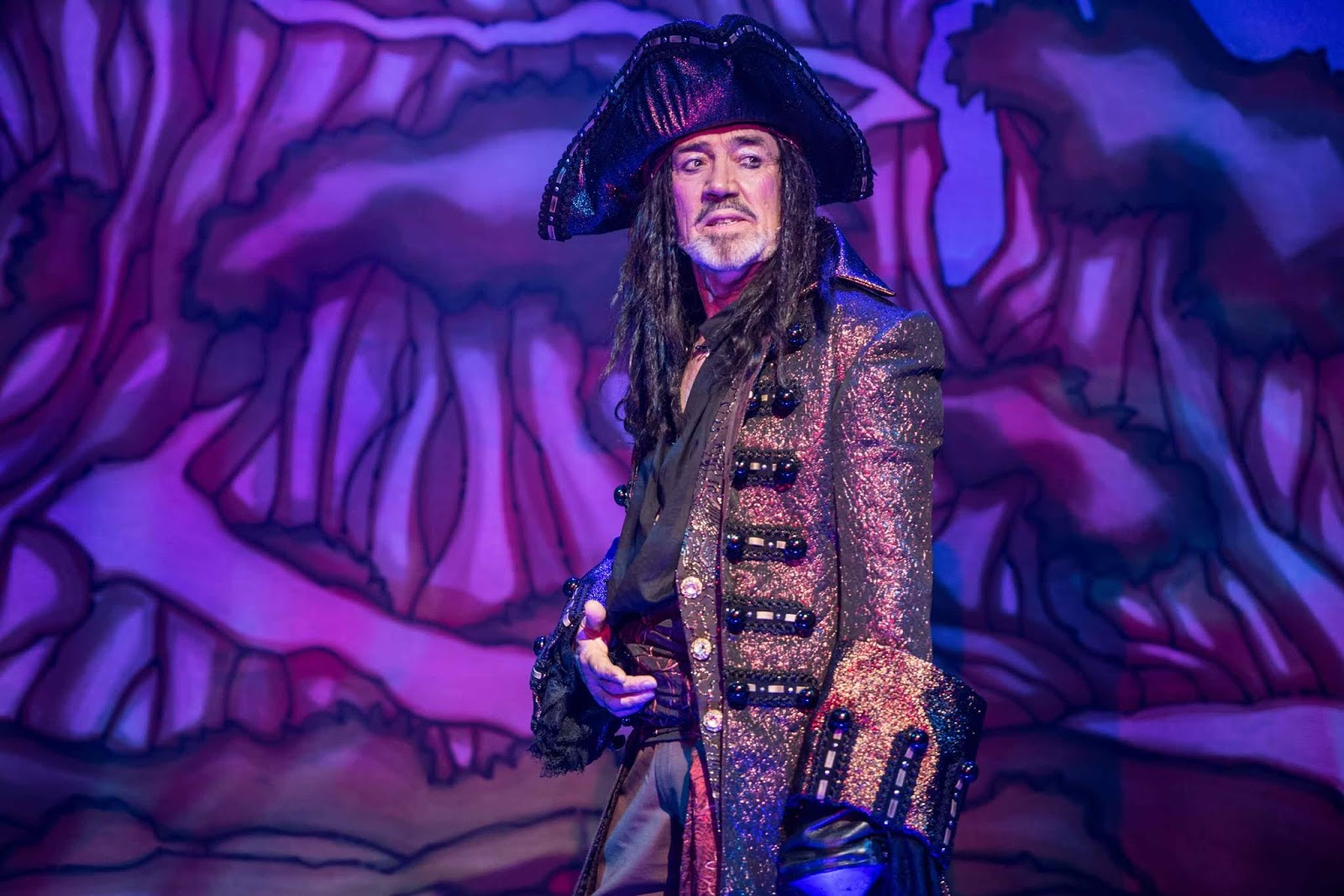 01f907e2b6b Robert Lindsay takes the starring role of Hook and has an absolute ball.  His Hook is the perfect comic panto villain – styled like Captain Jack  Sparrow (but ...