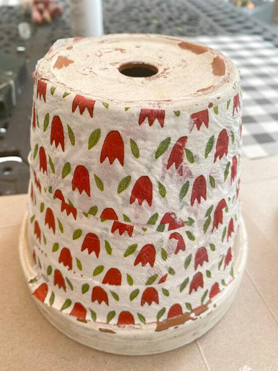Upside down decoupaged flower pot