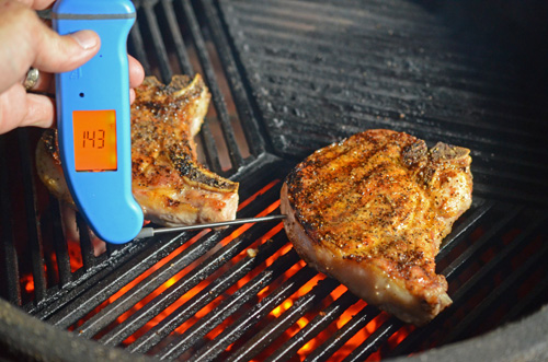 Using a Thermapen to check the temperature of the pork chops