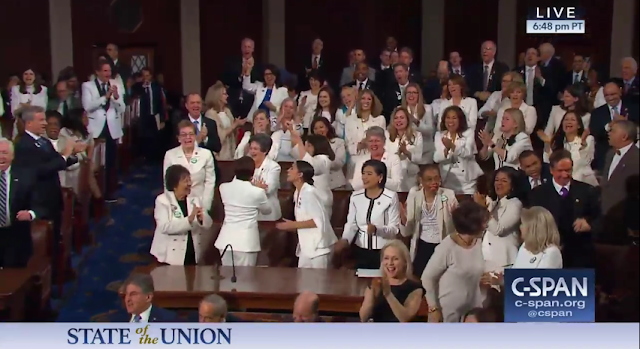 State of the Union 2019 Alexandria Ocasio-Cortez standing ovation USA chant working women House Democrats