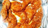 Marinated chicken on baking tray for chicken tikka kebab