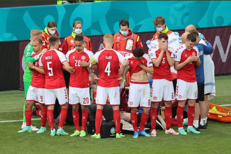 Denmark players form a ring around Christian Eriksen to shield the distressing scenes from the rest of the world