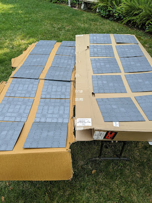 Unprimed tiles laid out ready to go.