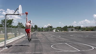 Tim McGaffin dunking the basketball