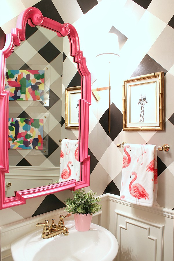 painted gingham walls, buffalo check walls, pink mirror, wainscoting, powder bath decor, brass sconces, cortland sconce, lucite towel bar