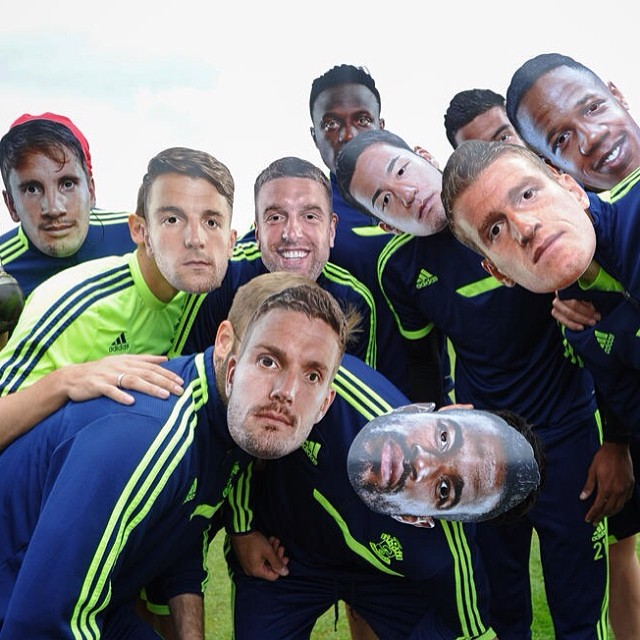 Southampton players try on 'selfie masks' to be given to traveling fans at Swansea