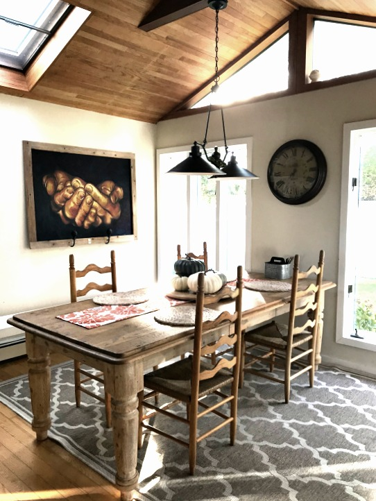 dining table with picture and ceiling chandelier