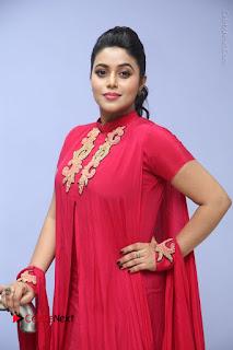 Actress Poorna Latest Stills in Red Dress at Rakshasi First Look Launch  0221.JPG