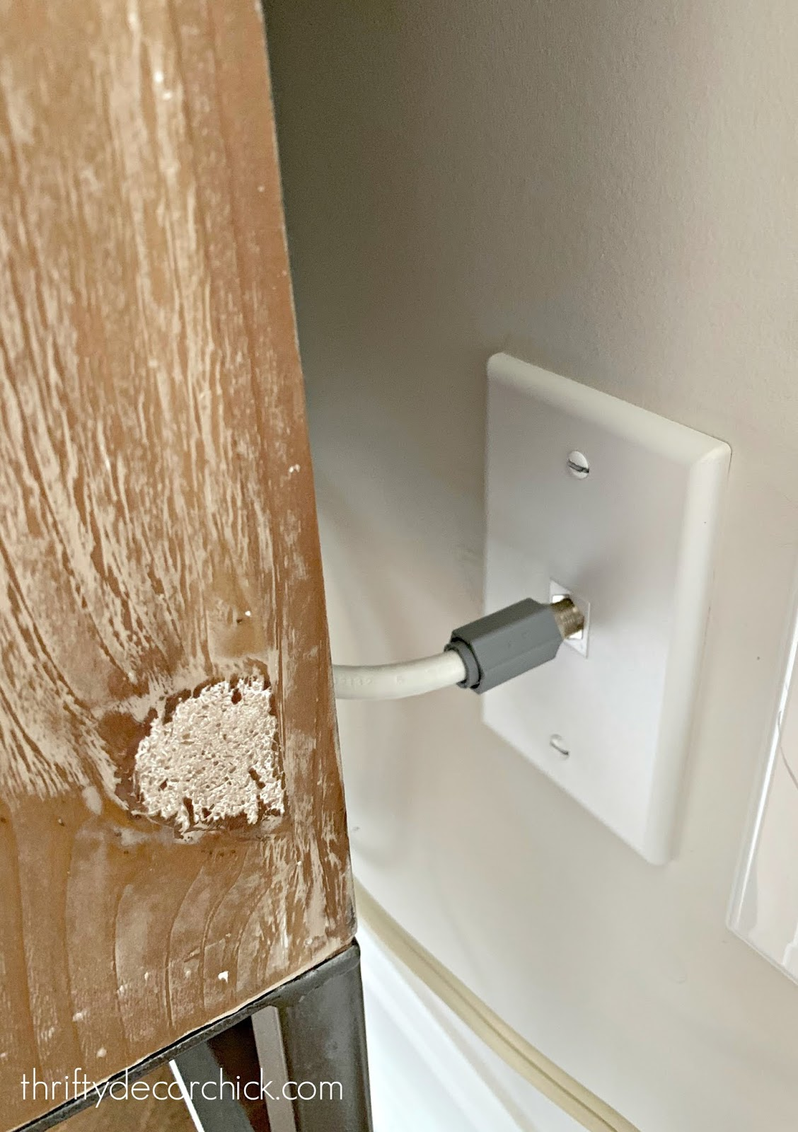 How to shorten cable outlet/cord behind furniture