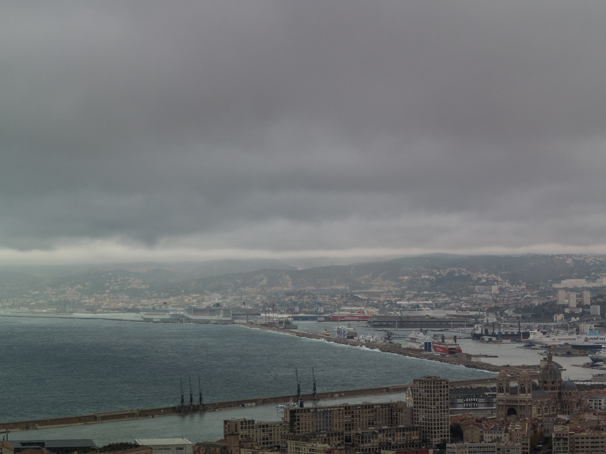 Marseille harbour seen from  the Basilica of Notre Dame de la Garde on a cloudy day.