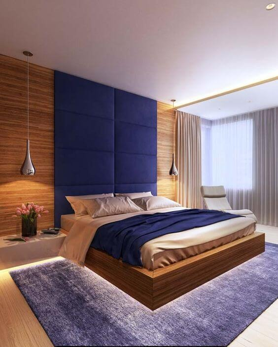 Floating bed with led and blue headboard