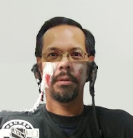 2 photos of a man spliced together showing a normal upper head matched with a lower head that is a zombie hockey player