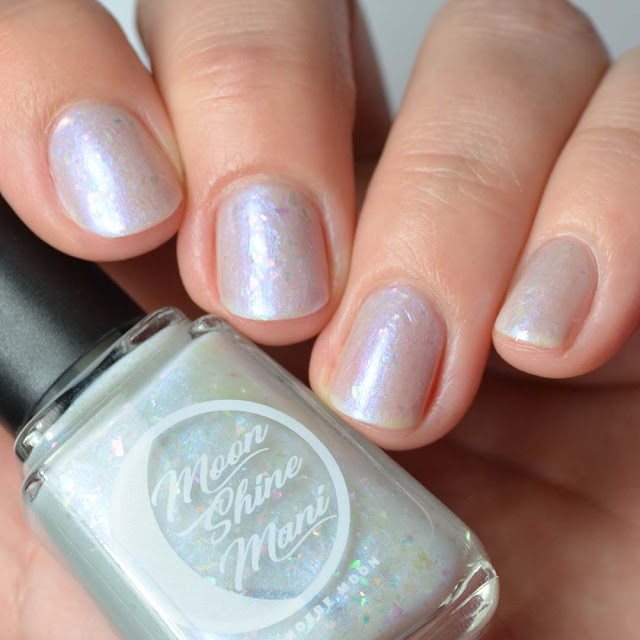 grey nail polish with flakies and shimmer
