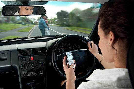 woman driving while texting - Image by cwazniak released via Creative Commons BY 2.0