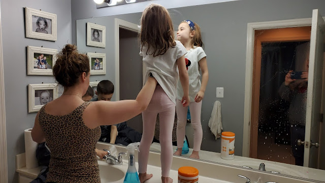 kids cleaning the bathroom